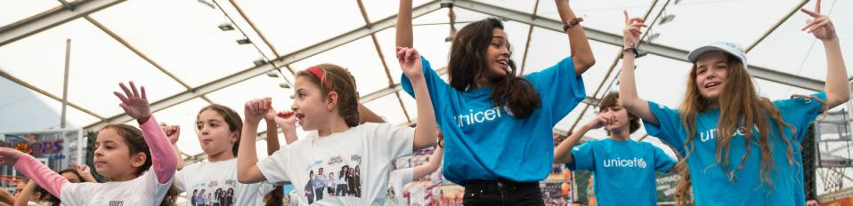 On 19 November 2016, Kids United team dancing with children during their visit to the Hoops Club to learn more about UNICEF